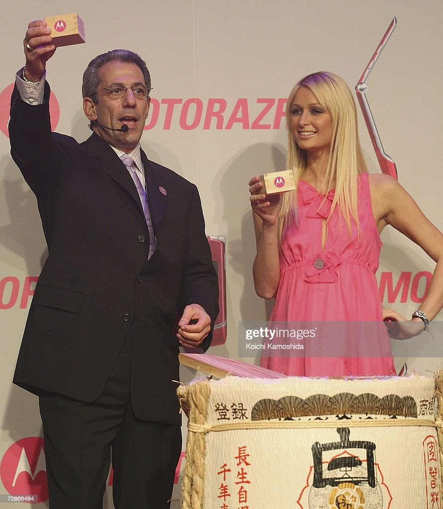 Paris Hilton and Motorola's corporate vice-president and general manager, Michael Tatelman make a toast during a mobile phone event at the Tsukiji Hongwanji Temple on December 22, 2006 in Tokyo, Japan.