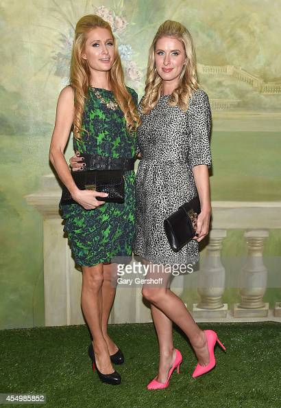 Paris Hilton and Nicky Hilton attend the Alice Olivia By Stacey Bendet presentation during MercedesBenz Fashion Week Spring 2015 at The Pierre Hotel...