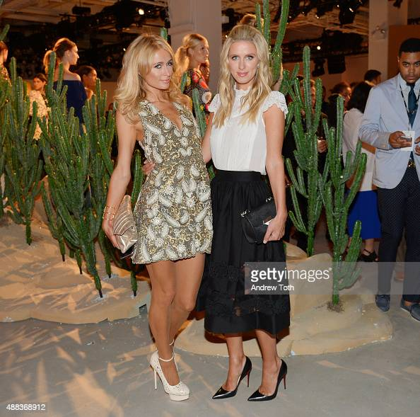 Paris Hilton and Nicky Hilton attend the Alice Olivia by Stacey Bendet presentation during Spring 2016 New York Fashion Week The Shows at The Gallery...