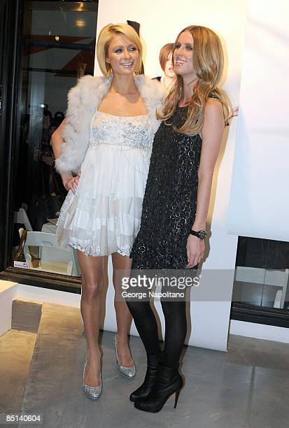 Paris Hilton and Nicky Hilton attend the Alice Olivia presentation during MercedesBenz Fashion Week Fall 2009 on February 16 2009 in New York City