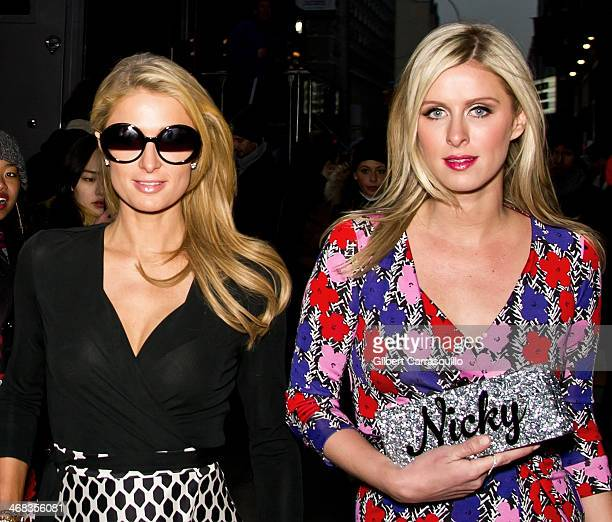 Paris Hilton and Nicky Hilton attend the Diane Von Furstenberg fashion show during MercedesBenz Fashion Week Fall 2014 at Spring Studios on February...