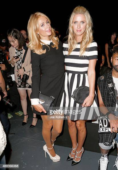Paris Hilton and Nicky Hilton attend the Michael Costello show during Spring 2016 New York Fashion Week at Pier 59 on September 15 2015 in New York...