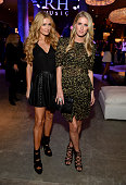 Paris Hilton and Nicky Hilton attend the opening of Restoration Hardware West Hollywood The Gallery on Melrose Avenue on October 22 2014 in Hollywood...