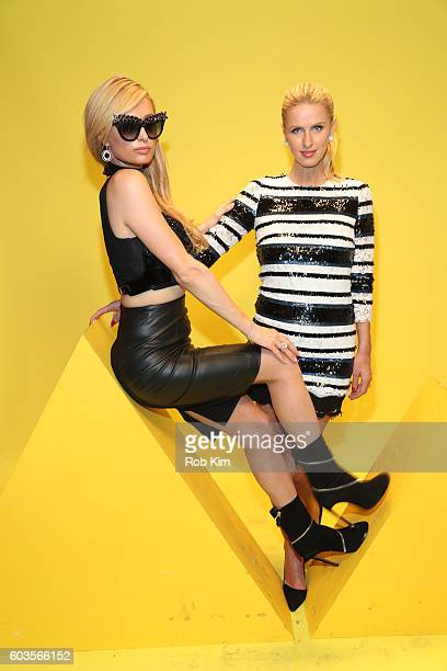 Paris Hilton and Nicky Hilton attend the W Magazine and Hugo Boss Celebrate 'The Shot' event at the International Center of Photography Museum on...