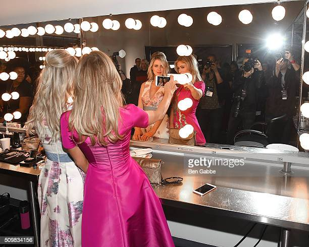 Paris Hilton and Nicky Hilton backstage at the Pamella Roland fashion show during Fall 2016 New York Fashion Week at Pier 59 on February 12 2016 in...