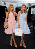 Paris Hilton and Nicky Hilton pose backstage at the Dennis Basso fashion show during MercedesBenz Fashion Week Spring 2015 at The Theatre at Lincoln...