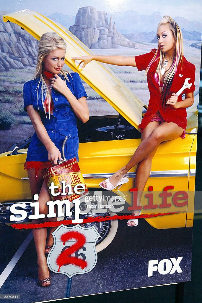 Paris Hilton (L) and Nicole Richie are seen on a poster for the 'Simple Life 2' Welcome Home Party at The Spider Club on April 14, 2004 in Hollywood, California.