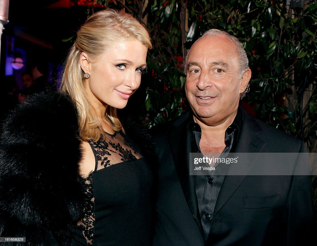 Paris Hilton and proprietor Sir Philip Green attend the Topshop Topman LA Opening Party at Cecconi's West Hollywood on February 13, 2013 in Los Angeles, California.