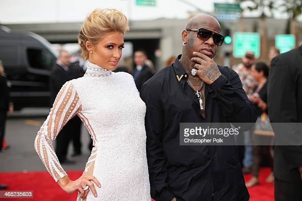 Paris Hilton and rapper Birdman attend the 56th GRAMMY Awards at Staples Center on January 26 2014 in Los Angeles California