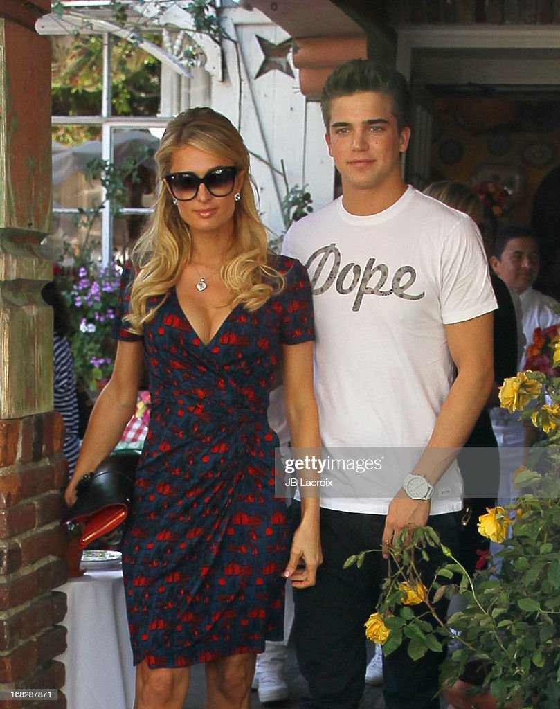 <a gi-track='captionPersonalityLinkClicked' href=/galleries/search?phrase=Paris+Hilton&family=editorial&specificpeople=171761 ng-click='$event.stopPropagation()'>Paris Hilton</a> and River Viiper are seen at The Ivy on May 7, 2013 in Los Angeles, California.