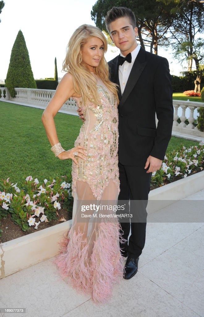 Paris Hilton and River Viiperi attend amfAR's 20th Annual Cinema Against AIDS during The 66th Annual Cannes Film Festival at Hotel du Cap-Eden-Roc on May 23, 2013 in Cap d'Antibes, France.