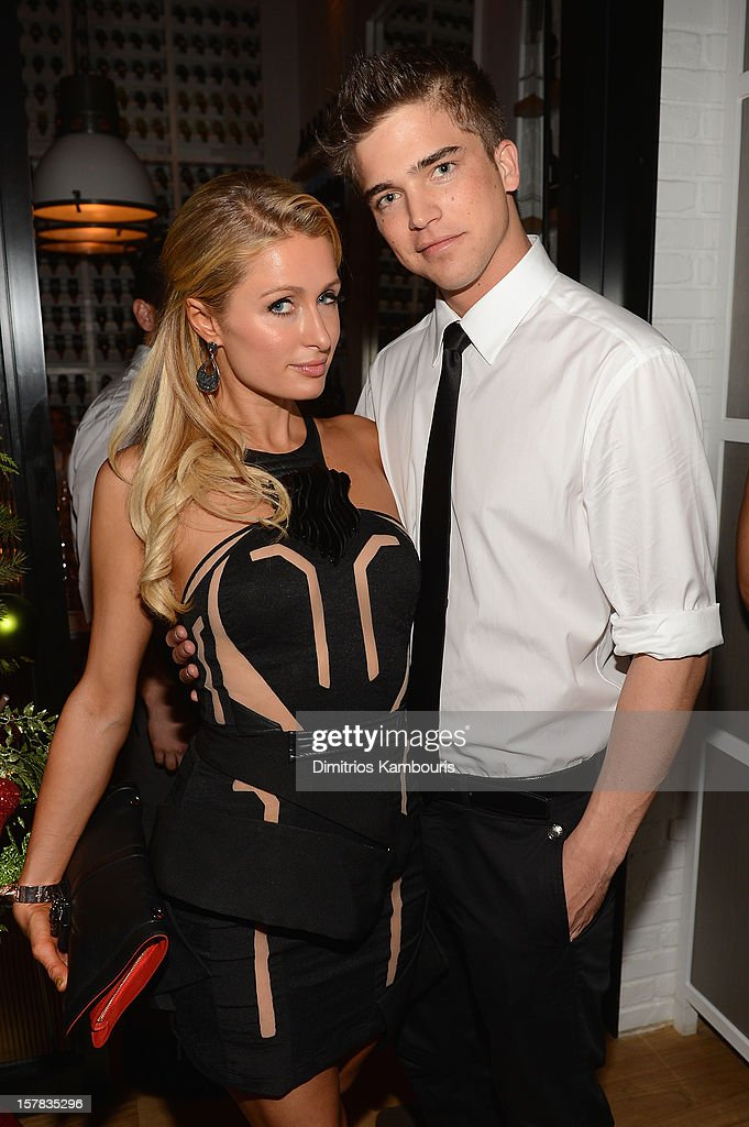 Paris Hilton and River Viiperi attend the Aby Rosen & Samantha Boardman dinner at The Dutch on December 6, 2012 in Miami, Florida.