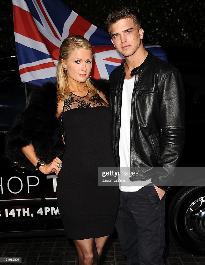 Paris Hilton and River Viiperi attend the Topshop Topman LA flagship store opening party at Cecconi's Restaurant on February 13, 2013 in Los Angeles, California.