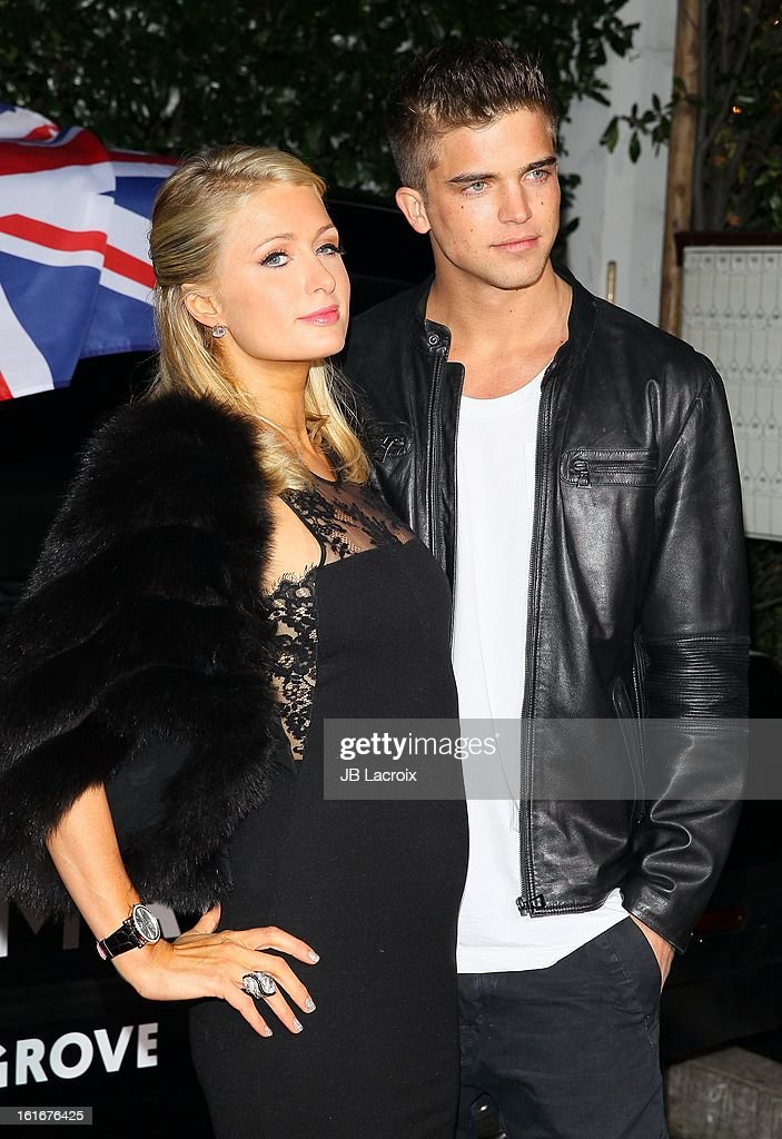 Paris Hilton and River Viiperi (R) attend the Topshop Topman LA Opening Party held at Cecconi's Restaurant on February 13, 2013 in Los Angeles, California.