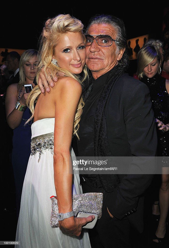 Paris Hilton and Roberto Cavalli attend amfAR's Cinema Against AIDS 2010 benefit gala dinner at the Hotel du Cap on May 20, 2010 in Antibes, France.