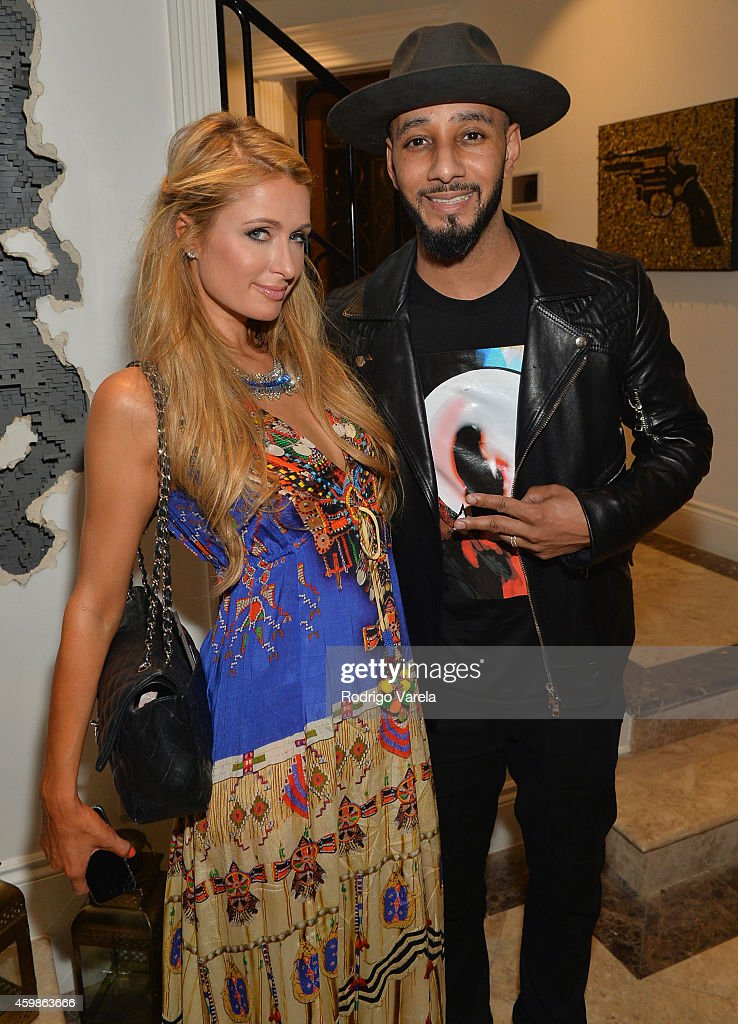 Paris Hilton and Swizz Beatz attend Grey Goose Le Melon Kehinde Wiley Preview Cocktail Reception at Private Residence on December 2 2014 in Miami...