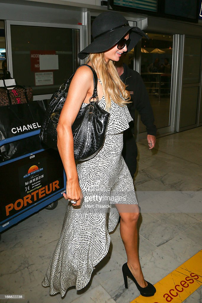 Paris Hilton arrives at Nice airport during the 66th annual Cannes Film Festival on May 15, 2013 in Nice, France.