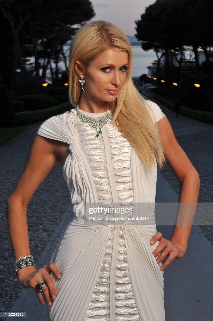 <a gi-track='captionPersonalityLinkClicked' href=/galleries/search?phrase=Paris+Hilton&family=editorial&specificpeople=171761 ng-click='$event.stopPropagation()'>Paris Hilton</a> arrives at the 2012 amfAR's Cinema Against AIDS during the 65th Annual Cannes Film Festival at Hotel Du Cap on May 24, 2012 in Cap D'Antibes, France.