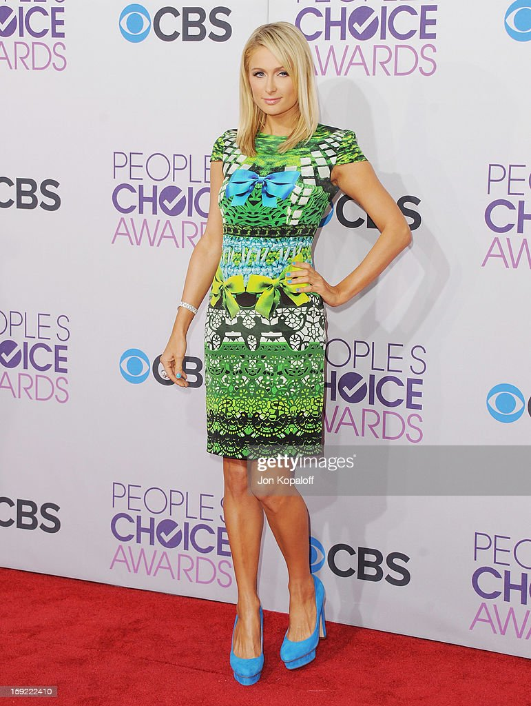 <a gi-track='captionPersonalityLinkClicked' href=/galleries/search?phrase=Paris+Hilton&family=editorial&specificpeople=171761 ng-click='$event.stopPropagation()'>Paris Hilton</a> arrives at the 2013 People's Choice Awards at Nokia Theatre L.A. Live on January 9, 2013 in Los Angeles, California.