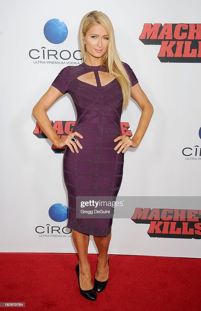 <a gi-track='captionPersonalityLinkClicked' href=/galleries/search?phrase=Paris+Hilton&family=editorial&specificpeople=171761 ng-click='$event.stopPropagation()'>Paris Hilton</a> arrives at the Los Angeles premiere of 'Machete Kills' at Regal Cinemas L.A. Live on October 2, 2013 in Los Angeles, California.