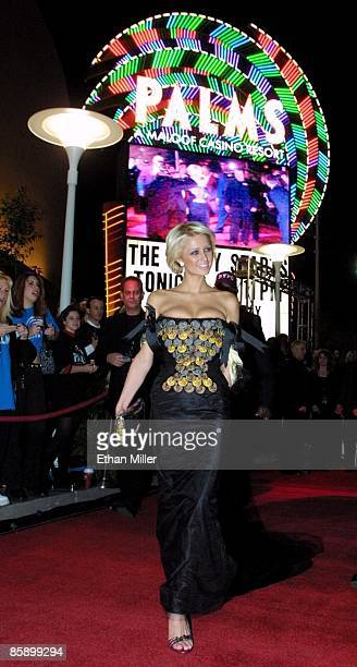 Paris Hilton arrives at the opening of the Palms Casino Resort wearing a dress with $1 million of Palms casino chips on it November 15 2001 in Las...