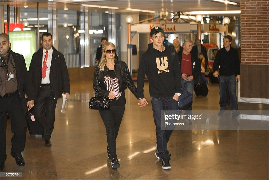 <a gi-track='captionPersonalityLinkClicked' href=/galleries/search?phrase=Paris+Hilton&family=editorial&specificpeople=171761 ng-click='$event.stopPropagation()'>Paris Hilton</a> arrives with her boyfriend Riper Viperi after landing at Brussels Airport on January 31, 2013 in Brussels, Belgium.
