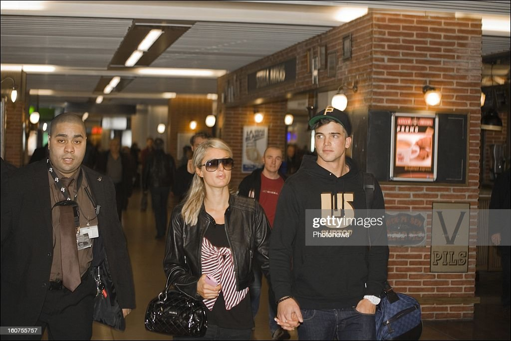 Paris Hilton arrives with her boyfriend Riper Viperi after landing at Brussels Airport on January 31, 2013 in Brussels, Belgium.
