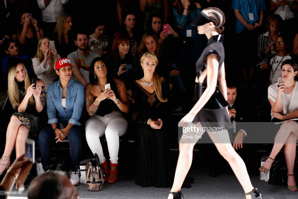 <a gi-track='captionPersonalityLinkClicked' href=/galleries/search?phrase=Paris+Hilton&family=editorial&specificpeople=171761 ng-click='$event.stopPropagation()'>Paris Hilton</a> (C) attends the Alon Livne fashion show during Mercedes-Benz Fashion Week Spring 2014 at The Studio at Lincoln Center on September 10, 2013 in New York City.