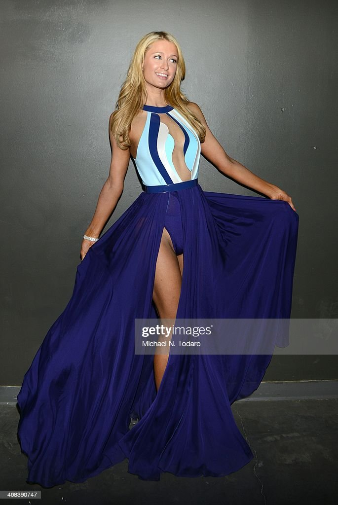 <a gi-track='captionPersonalityLinkClicked' href=/galleries/search?phrase=Paris+Hilton&family=editorial&specificpeople=171761 ng-click='$event.stopPropagation()'>Paris Hilton</a> attends the Alon Livne presentation during Mercedes-Benz Fashion Week Fall 2014 at The Hub at The Hudson Hotel on February 9, 2014 in New York City.