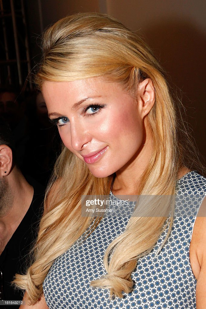Paris Hilton attends the Marlon Gobel Spring 2013 fashion show during MercedesBenz Fashion Week at the New York Public Library on September 8 2012 in...