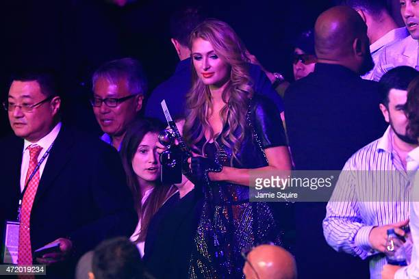 Paris Hilton attends the welterweight unification championship bout between Floyd Mayweather Jr and Manny Pacquiao on May 2 2015 at MGM Grand Garden...