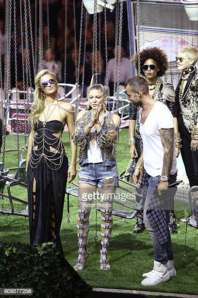 Paris Hilton Fergie and Philipp Plein acknowledge the aaplause of the audience at the Philipp Plein show during Milan Fashion Week Spring/Summer 2017...