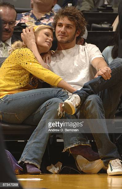 Paris Hilton gets close with Stavros Niarchos III as the Los Angeles Lakers play against the Phoenix Suns on April 16 2006 at Staples Center in Los...