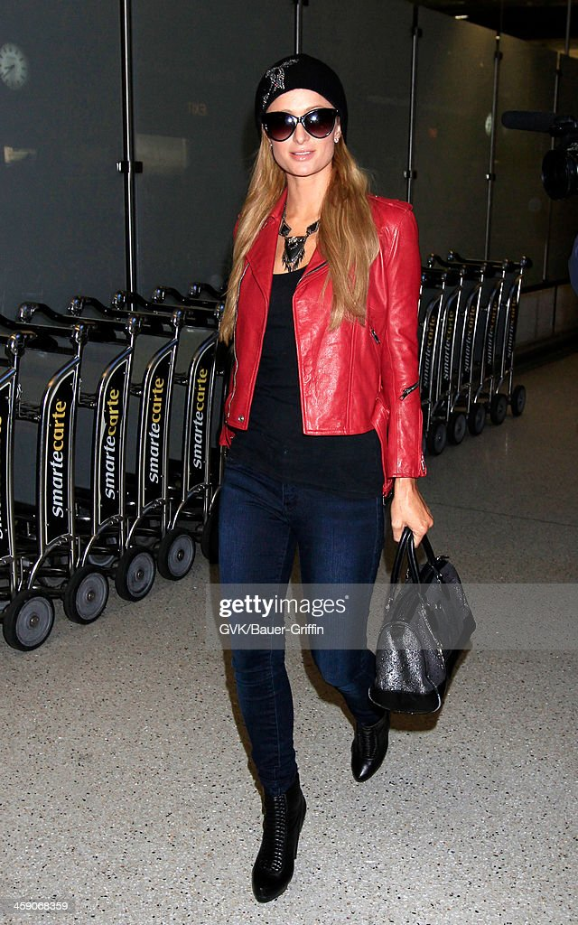 <a gi-track='captionPersonalityLinkClicked' href=/galleries/search?phrase=Paris+Hilton&family=editorial&specificpeople=171761 ng-click='$event.stopPropagation()'>Paris Hilton</a> is seen at LAX airport on December 22, 2013 in Los Angeles, California.
