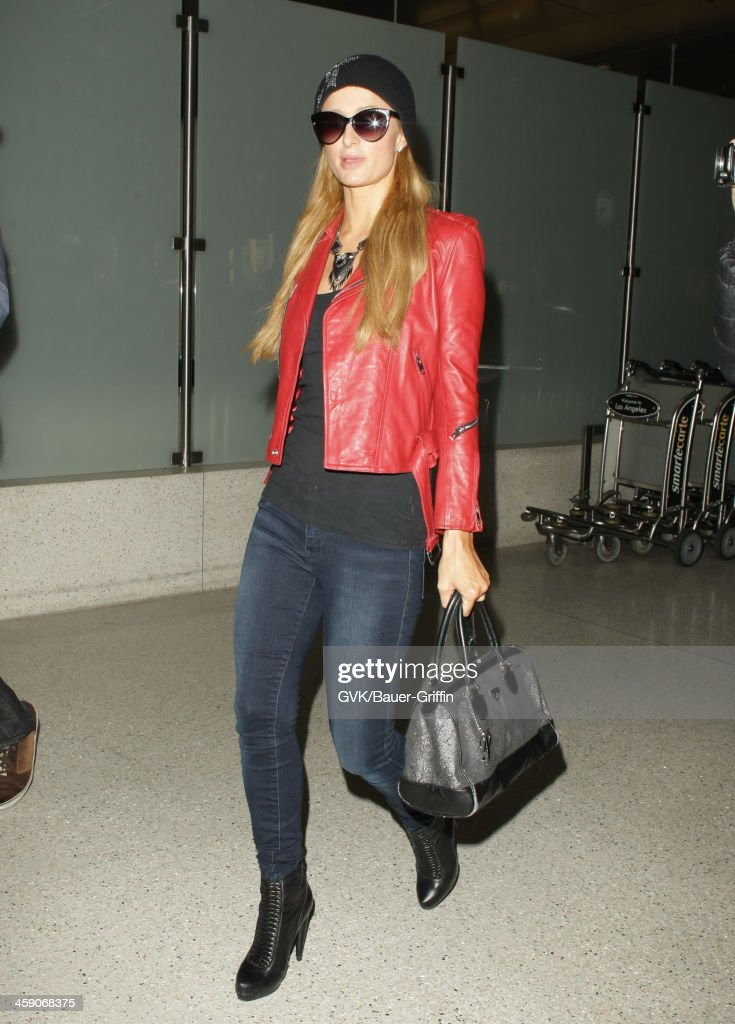 Paris Hilton is seen at LAX airport on December 22, 2013 in Los Angeles, California.
