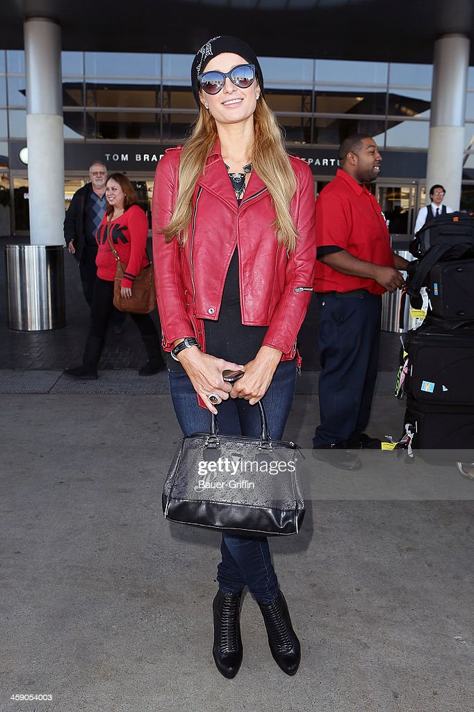 Paris Hilton is seen at Los Angeles International Airport on December 22, 2013 in Los Angeles, California.
