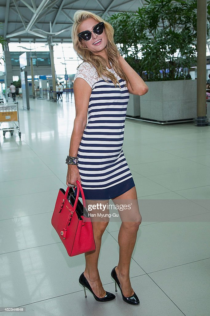 <a gi-track='captionPersonalityLinkClicked' href=/galleries/search?phrase=Paris+Hilton&family=editorial&specificpeople=171761 ng-click='$event.stopPropagation()'>Paris Hilton</a> is seen on departure at Incheon International Airport on July 18, 2014 in Incheon, South Korea.