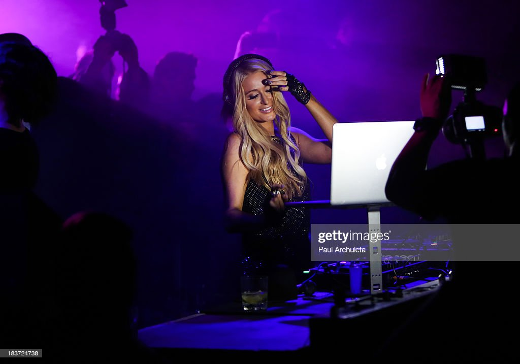 Paris Hilton performs at the release party for her new single 'Good Time' featuring Lil Wayne at on October 8, 2013 in Hollywood, California.