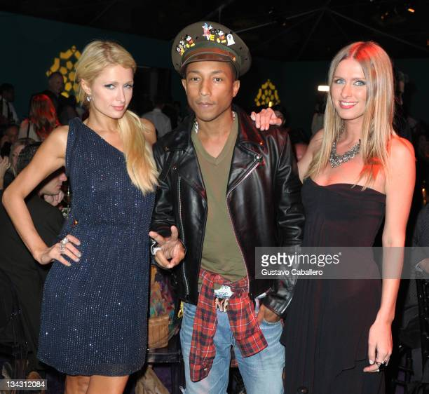 Paris Hilton Pharrell Williams and Nicky Hilton attend the Maybach and MOCA celebration of Art Basel Miami Beach at Raleigh Hotel on November 30 2011...