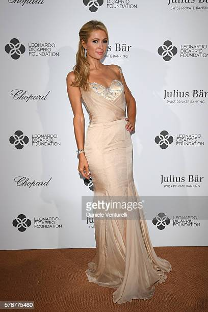 Paris Hilton poses at a photocall during The Leonardo DiCaprio Foundation 3rd Annual SaintTropez Gala at Domaine Bertaud Belieu on July 20 2016 in...