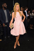Paris Hilton poses backstage at the Dennis Basso fashion show during MercedesBenz Fashion Week Spring 2015 at The Theatre at Lincoln Center on...