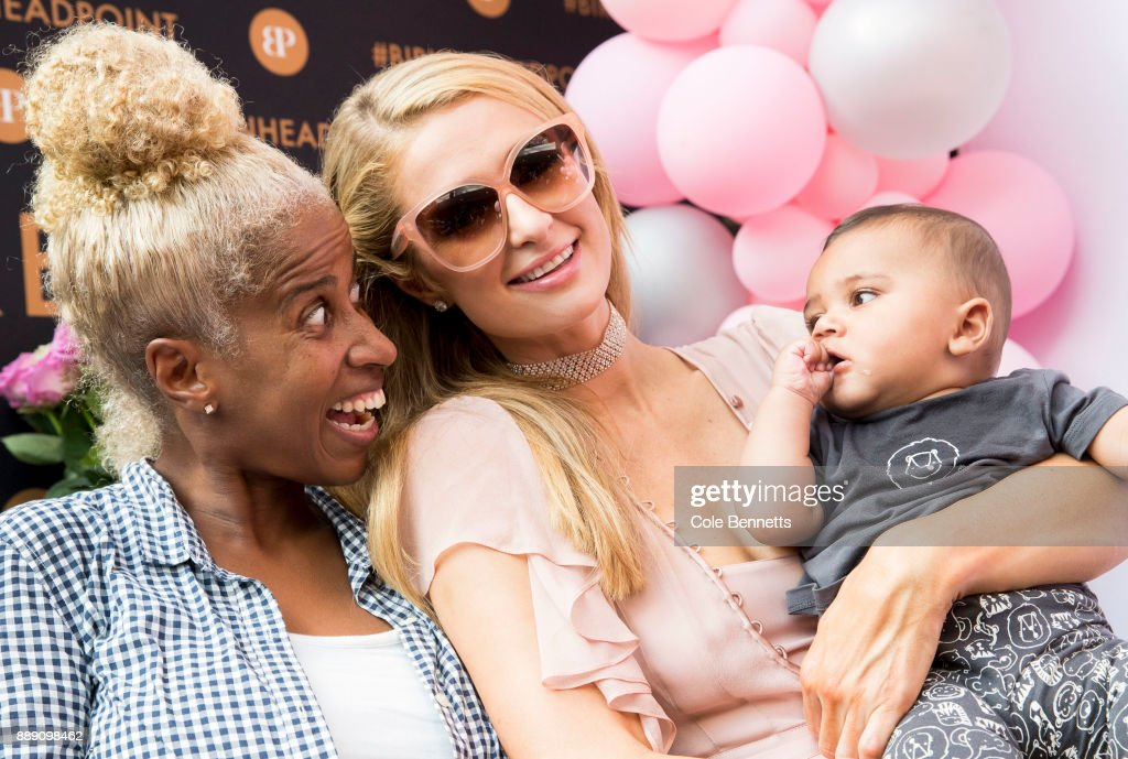 Paris Hilton poses for a photo holding a fans baby during a promotion visit to Australia to launch her 23rd fragrance, Rosé Rush on November 30, 2017 in Sydney, Australia.
