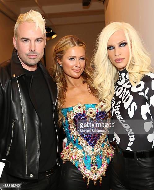 Paris Hilton poses for a photo with designers David Blond and Phillipe Blond backstage at The Blonds fashion show during MADE Fashion Week Fall 2015...