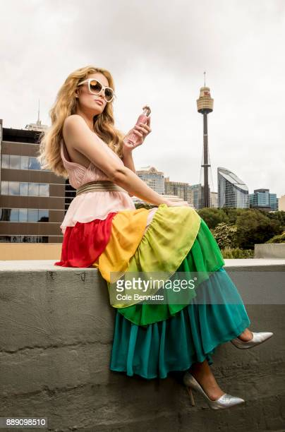 Paris Hilton poses for a photoshoot on the MTV rooftop during a promotion visit to Australia to launch her 23rd fragrance Rosé Rush on November 29...