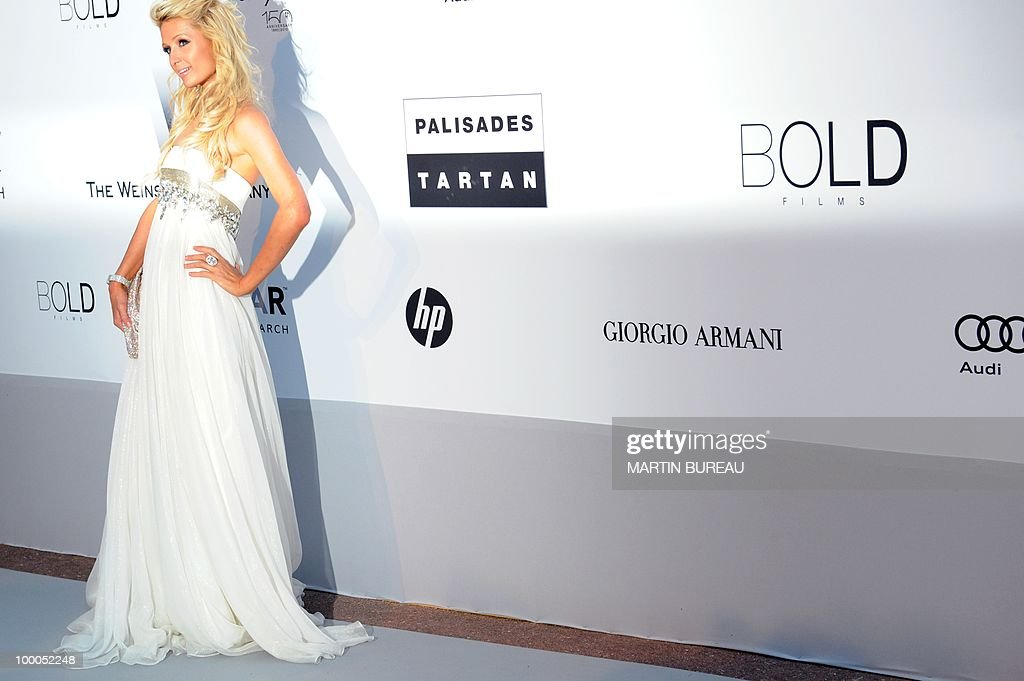 US Paris Hilton poses while arriving to attend the 2010 amfAR's Cinema Against Aids on May 20, 2010 in Antibes, southeastern France.