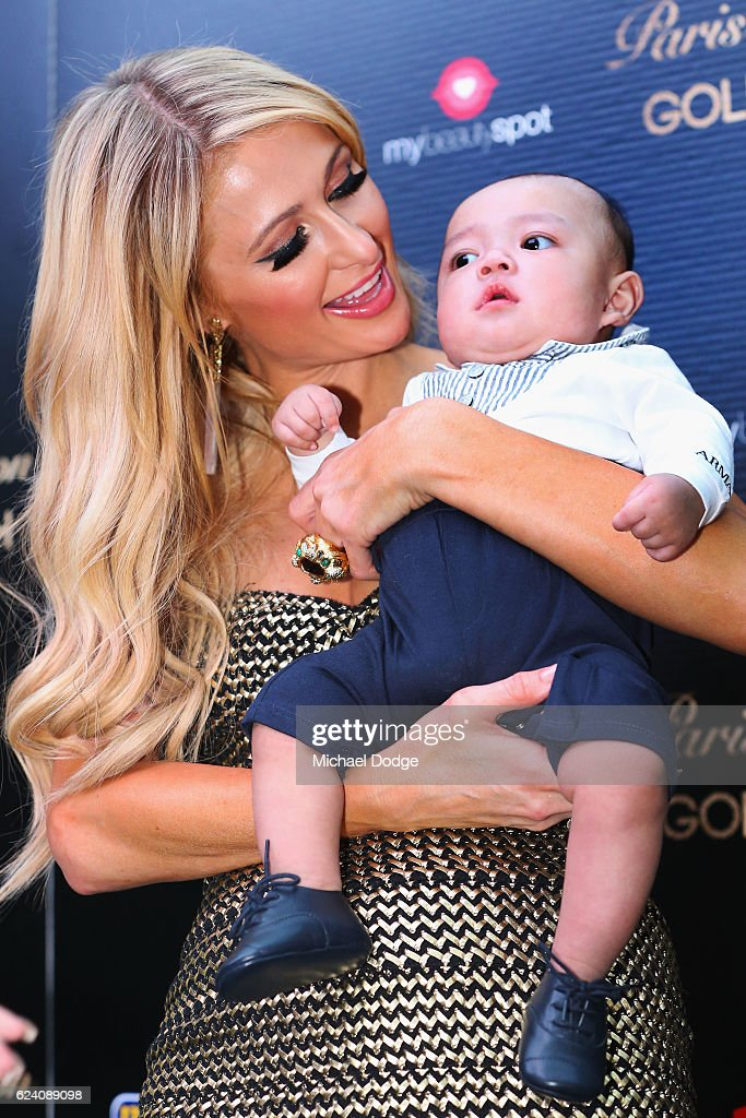 Paris Hilton poses with fans baby during a Q&A with fans at Westfield Doncaster on November 18, 2016 in Melbourne, Australia.