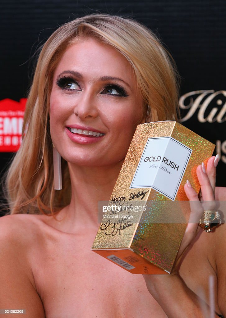 Paris Hilton poses with her latest perfume during a Q&A with fans at Westfield Doncaster on November 18, 2016 in Melbourne, Australia.