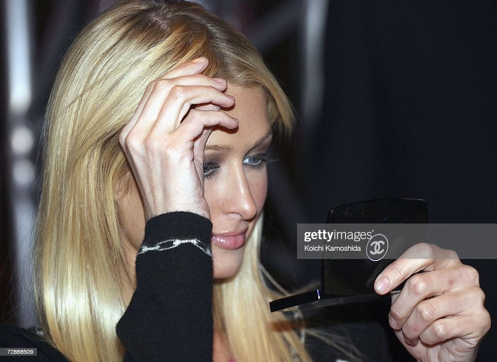 Paris Hilton prepares backstage during a mobile phone event at the Tsukiji Hongwanji Temple on December 22, 2006 in Tokyo, Japan.