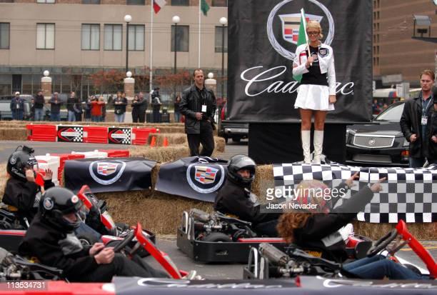 Paris Hilton prepares to start the race as Leeann Tweeden raises her arms