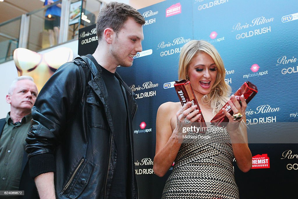 Paris Hilton receives chocolate Tim Tams from a fan during a Q&A with fans at Westfield Doncaster on November 18, 2016 in Melbourne, Australia.